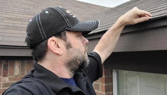 Kevin Cearley, professional home inspector, performing a home inspecion in New Braunfels, Texas.