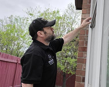 Kevin Cearley, Licensed Home Inspector, inspecting the window of a home in New Braunfels, Texas.