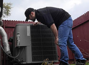 Kevin Cearley, Licensed Home Inspector, inspecting the air conditioning system of a home in New Braunfels, Texas.